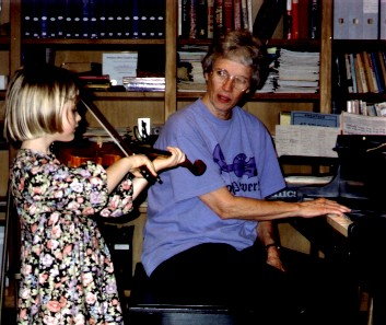 Jody Naifeh and Emma Jane work through a measure in Jody's studio. (c) The Pendleton Family Fiddlers
